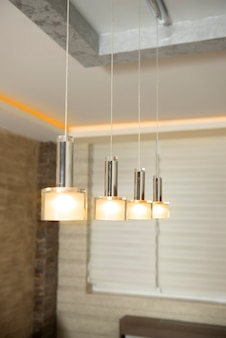 Plastic white modern chandelier in a renovated home