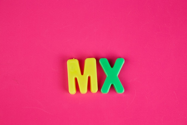 Plastic words (toys) isolated in pink background
