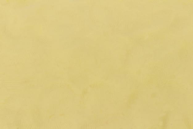 Plasticine beige textured background