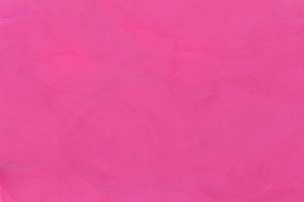 Plasticine pink textured background