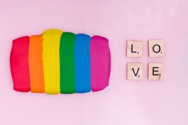 Plasticine sticks and text wooden blocks with word love