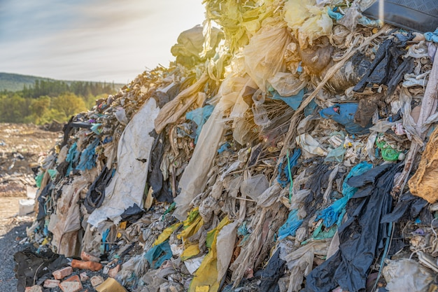 Plastics and other waste in a pile at a landfill