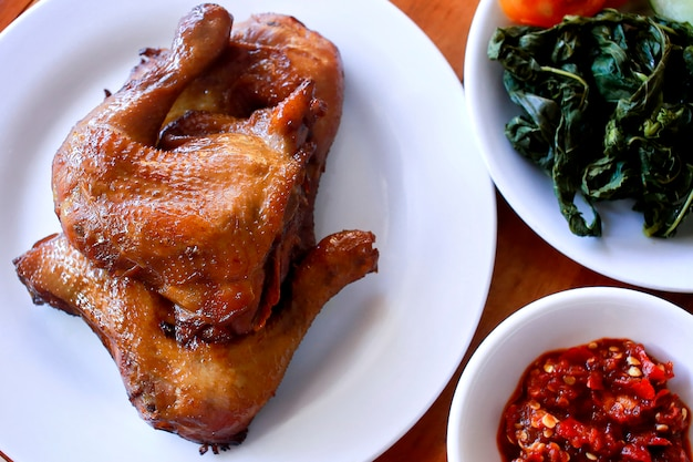 Plate of ayam bakar madu, traditional grilled chicken from indonesia