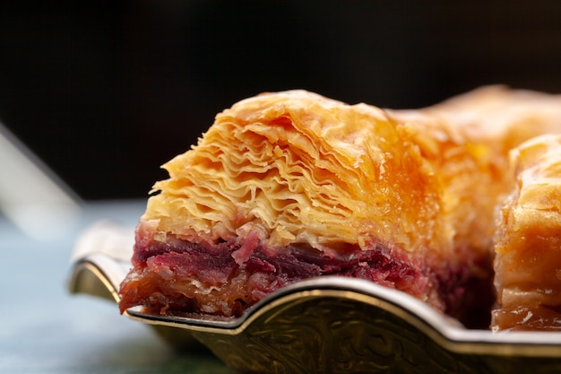 Plate of baklava dessert close up served on table