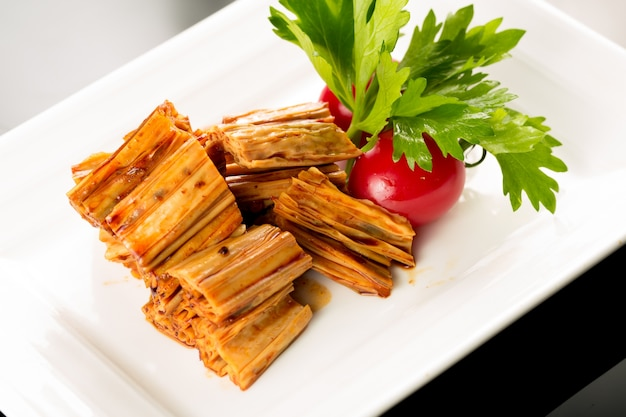 Plate of beancurd with tomatoes