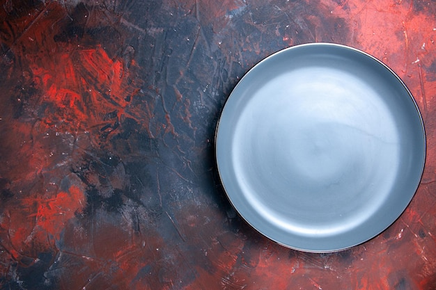Plate blue round plate on the right side of the table