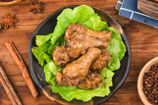 A plate of braised chicken wings