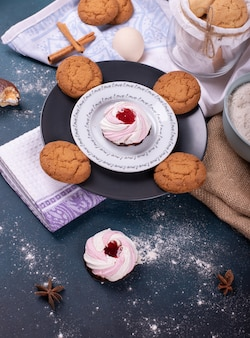 Plate of cake and biscuits and flour