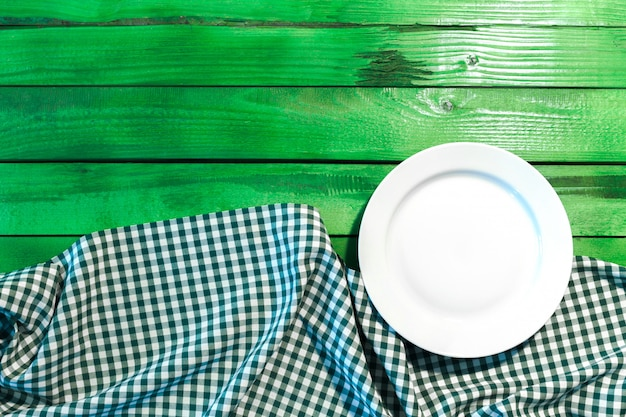 The plate on checkered table cloth