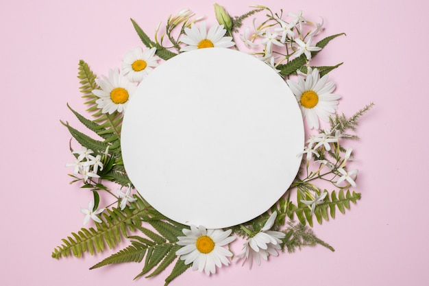 Plate on composition of wonderful blooms and plants