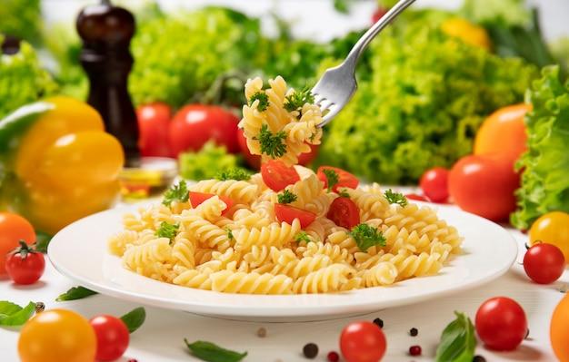 Plate of cooked italian fusilli pasta