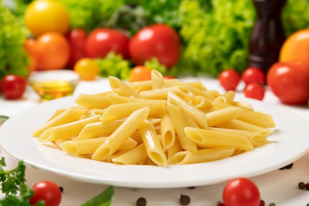 Plate of cooked italian penne pasta