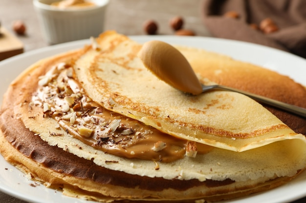Plate of crepes with peanut butter and nuts