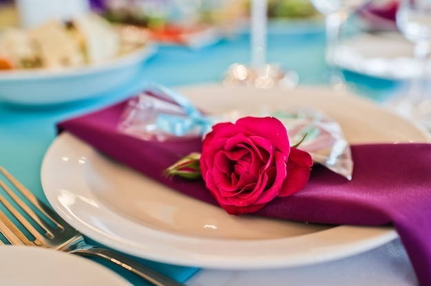 Plate decorated with a rose, a festive dinner in the restaurant