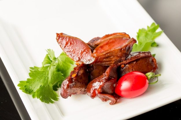 Plate of duck meat with garnish