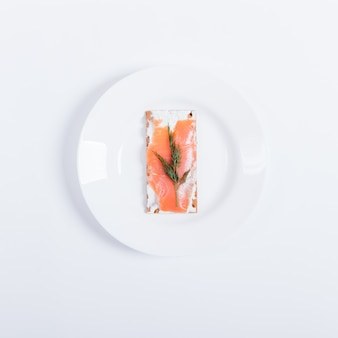 Plate of food: bread, cream cheese, smoked salmon and dill