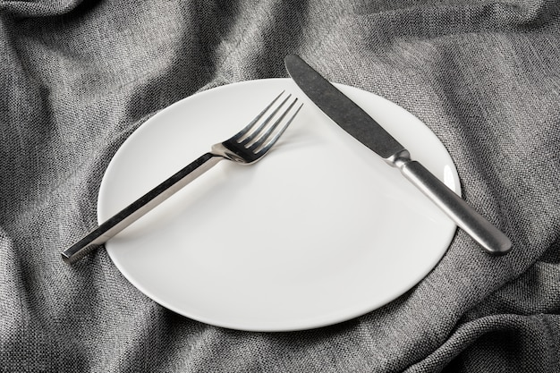 Plate fork spoon on fabric clothes clear and without depth of field