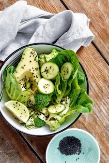 Plate fresh green salad wooden  diet food