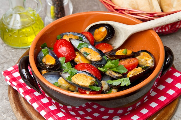 Plate of fresh mussels with tomatoes