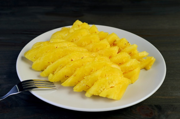 Plate of fresh ripe pineapple slices for a tasty and healthy dessert
