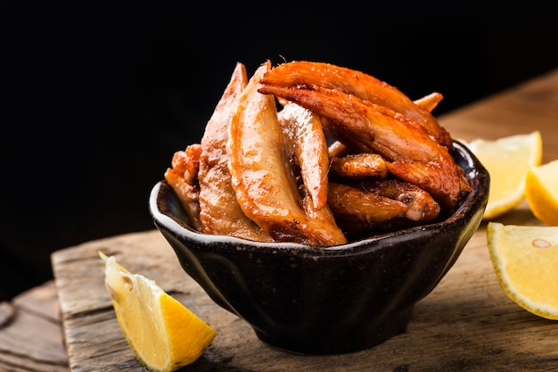 A plate of freshly baked chicken wings,chicken wing tip