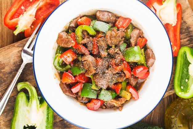 Plate of fried beef cubes with green pepper