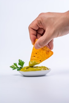 Plate full of nachos with guacamole
