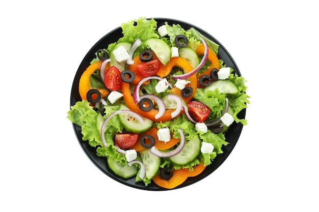Plate of greek salad isolated on white