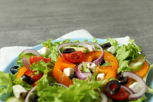 Plate of greek salad and kitchen towel, close up