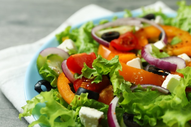 Plate of greek salad and kitchen towel