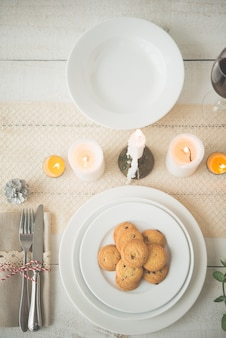 Plate of homemade biscuits on table set up for christmas dinner