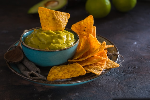 Plate of homemade guacamole with nachos.