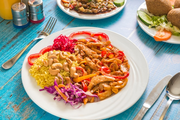 A plate of mexican chicken meal