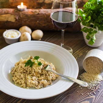 Plate of mushroom risotto topped with grated cheese