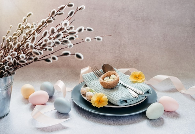 Plate, napkin, tableware, easter eggs and willow catkin branches