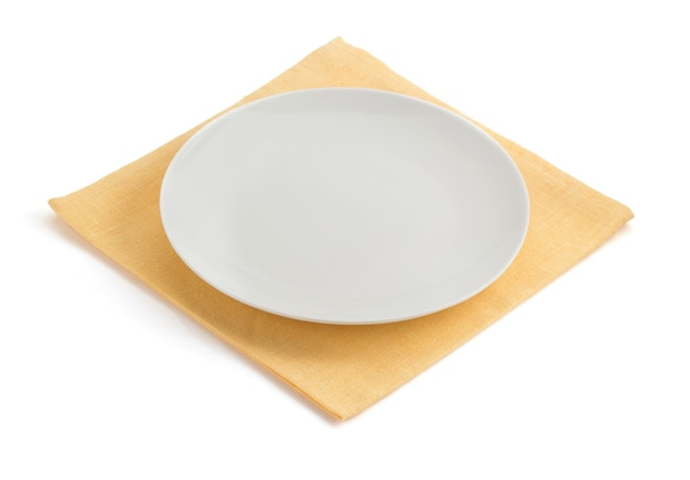 Plate at napkin on white background