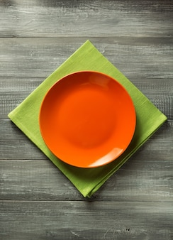 Plate and napkin at wooden table