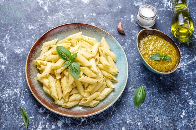 Plate of pasta with homemade pesto sauce.