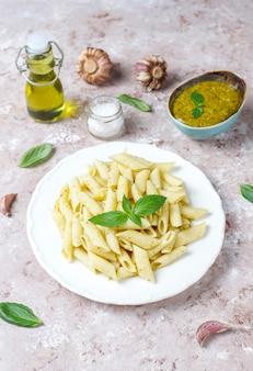Plate of pasta with homemade pesto sauce