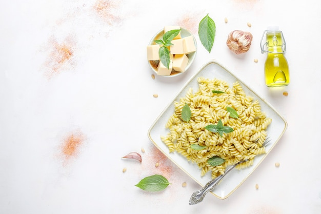 Plate of pasta with homemade pesto sauce.