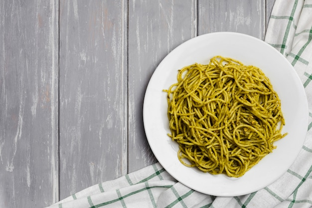 Plate of pasta with wooden background