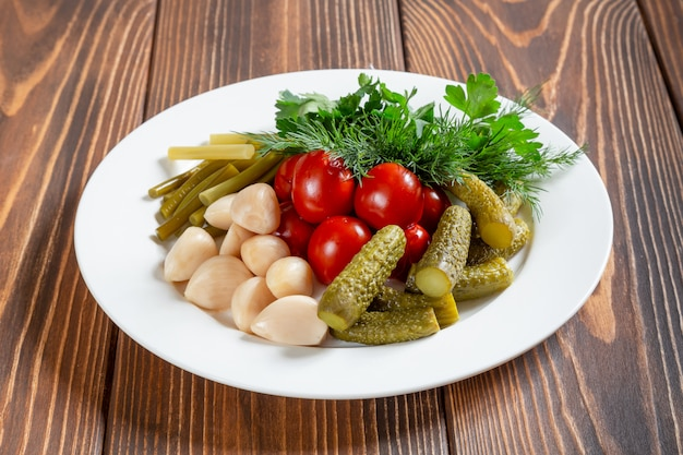 Plate of pickles on wooden table