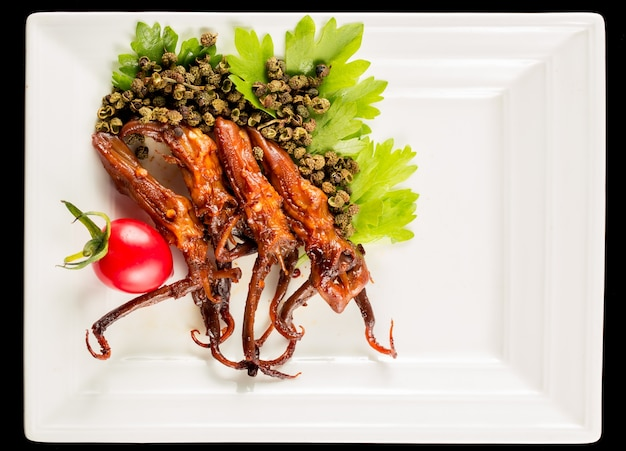 Plate of pig tongue with garnish
