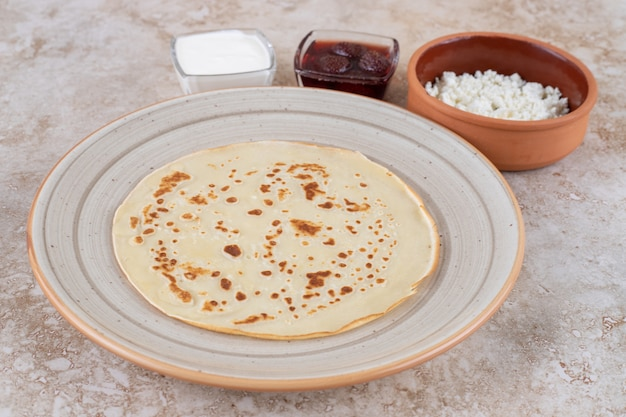 A plate of roll pancakes with cottage cheese