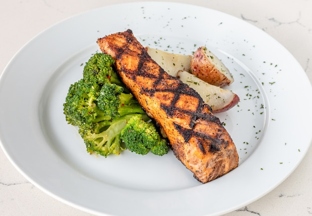 Plate of salmon steak with broccoli