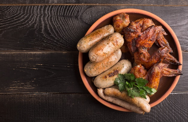 Plate of sausages and chicken wings