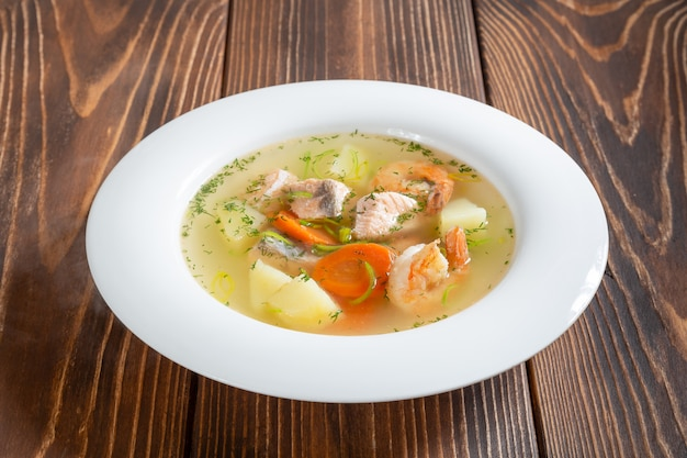 Plate of seafood soup with shrimps and salmon