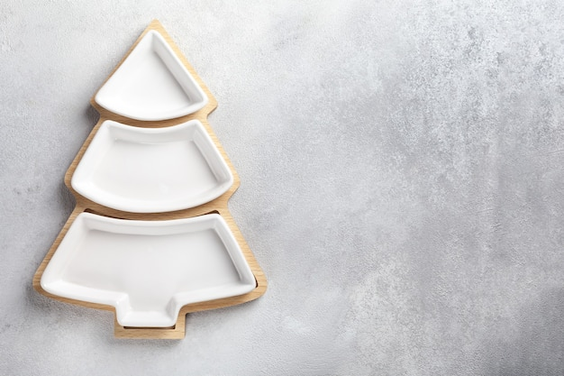 A plate for snacks in the form of a christmas tree on a light background