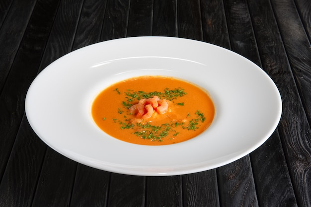 Plate of soup with shrimps