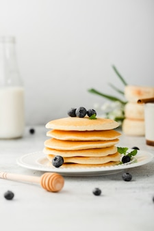 Plate stack of pancakes with cranberries